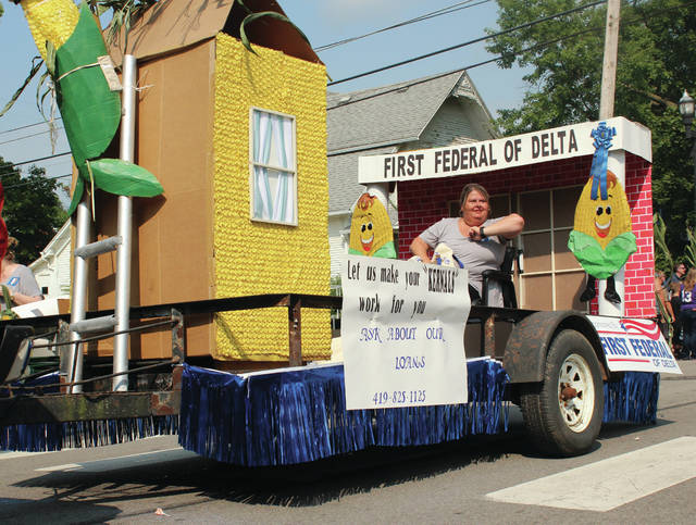 The First Federal Of Delta float travels down Main Street in Swanton during last year's Corn Festival parade.
