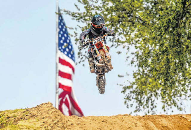 Landon Husted, an upcoming third grader at Evergreen Elementary School, racing his dirt bike. The 9-year-old has qualified for the Loretta Lynn's Amateur National Motocross Championship to take place July 29-Aug. 3 in Hurricane Mills, Tenn.