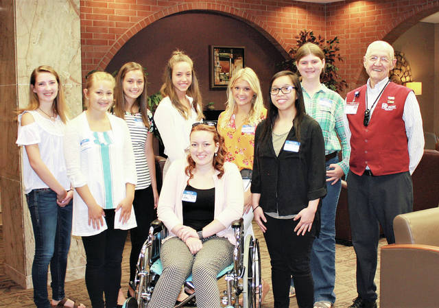 Amy Shaffer of Morenci, Mich., acted as the patient during wheelchair training at the 24th Annual Fulton County Health Center Health Care Camp, held June 27. Behind her, from left, are Kennedy Sinks, Ally Sprow, Riley Garretson, Bailey Johnson, Meredith Zeiter, Maxie Ratanasri, Justus Schroeder, and volunteer Bob Lehman.