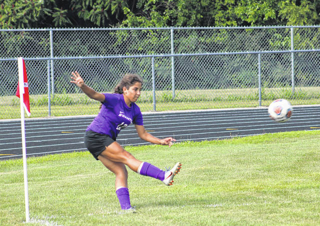 Swanton's Aricka Lutz boots a corner kick Friday in the season opener versus Van Buren. Lutz scored a goal off a free kick with 39 seconds remaining to seal the 3-2 win for the Bulldogs.