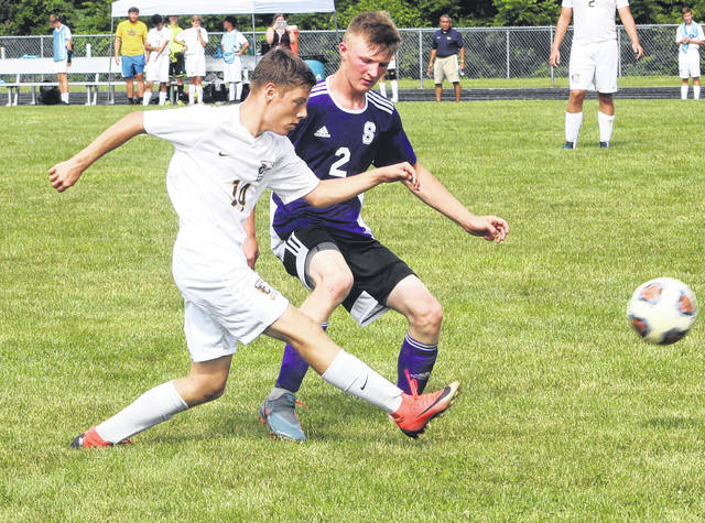Swanton's Jonathon Byczynski (2) defends during the loss to Toledo Christian on Saturday.