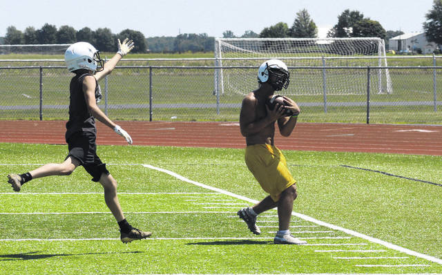 Evergreen's Brian Floyd hauls in a pass near the sideline during a group offense portion of Friday's two-a-day practice.