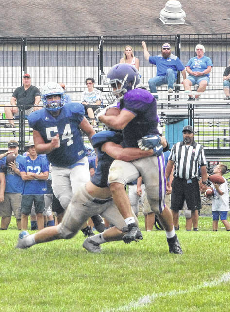 Swanton running back Tyler Gowing carries the ball against Elmwood Saturday.