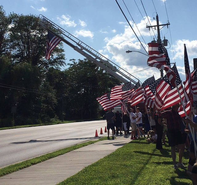 The procession traveled from Toledo Express Airport, through Swanton, and westward, ending in Bryan. Visitation was held Friday, and funeral services were held Saturday at Bryan High School.