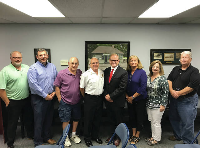 The current and future Swanton fire chiefs stand with members of Swanton Village Council at Monday's meeting. Pictured, from left, are Craig Rose, Michael Rochelle, Paul Dzyak, current chief Michael Wolelver, future chief Anthony Schaffer, Mayor Ann Roth, Dianne Westhoven, and Jeff Pilliod.