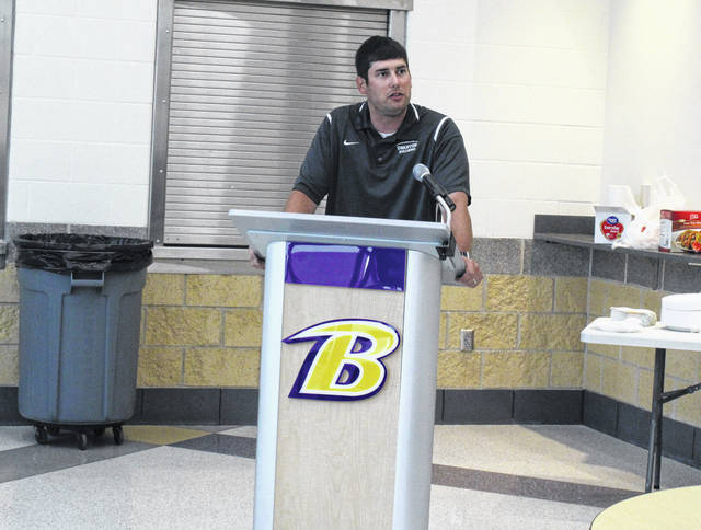 Swanton first-year head coach Denton Saunders talks a little about his team Sunday night at the Northwest Ohio Athletic League football coaches meeting held in Bryan. Saunders and the Bulldogs were picked seventh by their peers.