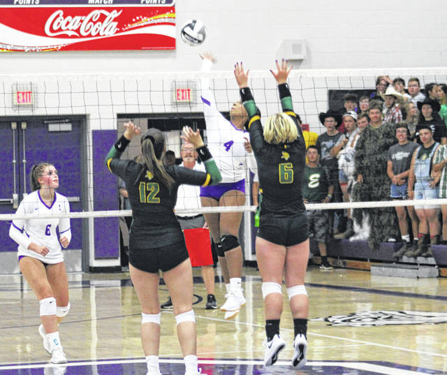 Ashlynn Waddell of Swanton shoots one over the Evergreen defense during a NWOAL volleyball match Tuesday in Swanton. The Bulldogs rolled to a 25-17, 28-26, 25-9 sweep of the Vikings.