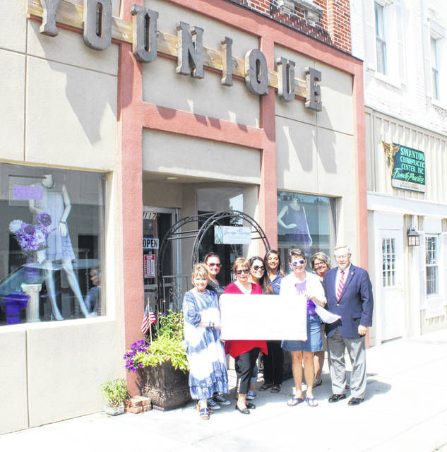 Joyce Berry presents a donation to Jana Broglin, Historical Society Secretary, Mona Dyke, Historical Society Vice President, and Neil Toeppe, Histoical Society President. In the back row are Shannon Heilman and Tara Shaver from The Posh Pallet Boutique and Jessica Poulson and Shelly Keifer from First Federal Bank of Delta.
