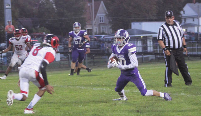 Swanton's Justyn Bartlett makes a move upfield against Rogers on Friday. He scored the game's first touchdown.