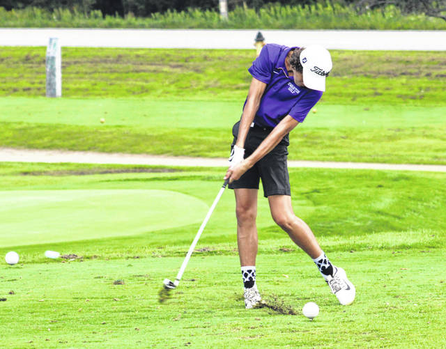 Swanton's Sam Betz hits his first shot at the 15th hole at Valleywood Thursday versus Liberty Center. The Bulldogs topped the Tigers to improve to 2-1 in league play.