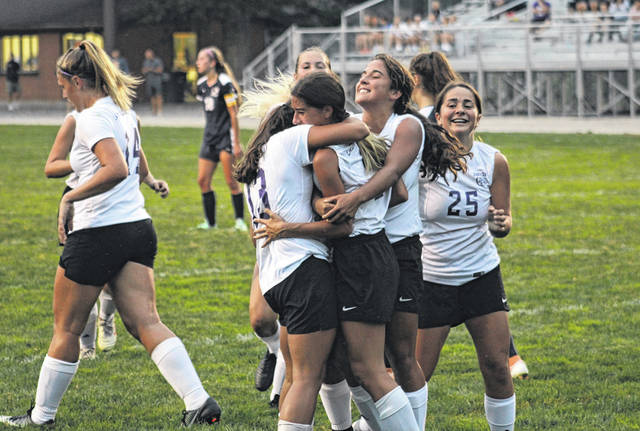 Several Bulldogs celebrate with Caroline Vargas after the sophomore scored what ended up being Swanton's lone goal versus Archbold Thursday in NWOAL girls soccer. The Bulldogs and Blue Streaks finished in a 1-1 tie.