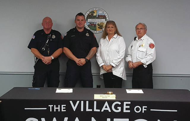 Jim Harrison, left, and Shawn Bowman were sworn-in as lieutenants at the Sept. 9 Swanton Village Council with Mayor Ann Roth and Fire Chief Mike Wolever, right.