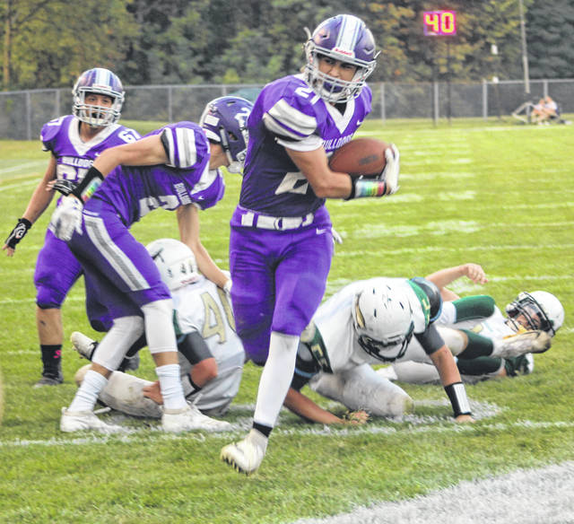 Ian Saunders scores a first quarter touchdown to put Swanton on the board Friday.