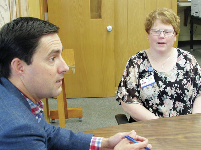Ohio Secretary of State Frank LaRose, left, sat down Aug. 28 with Fulton County Board of Elections Director Melanie Gilders, right, District 2 Senator Theresa Gavarone, and BOE staff members to discuss a security directive he issued this summer.