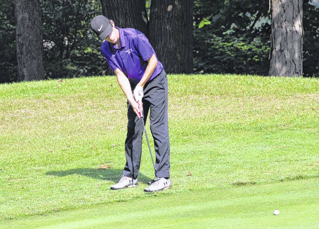 Swanton's Garrett Swank with a putt during the NWOAL Golf Tournament on Friday at Auglaize Golf Course in Defiance. Swank finished fourth overall, carding a 79 for the Bulldogs.