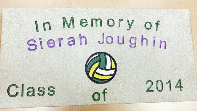 Joughin The plaque that accompanies one of two trees planted at Evergreen High School in memory in Sierah Joughin.