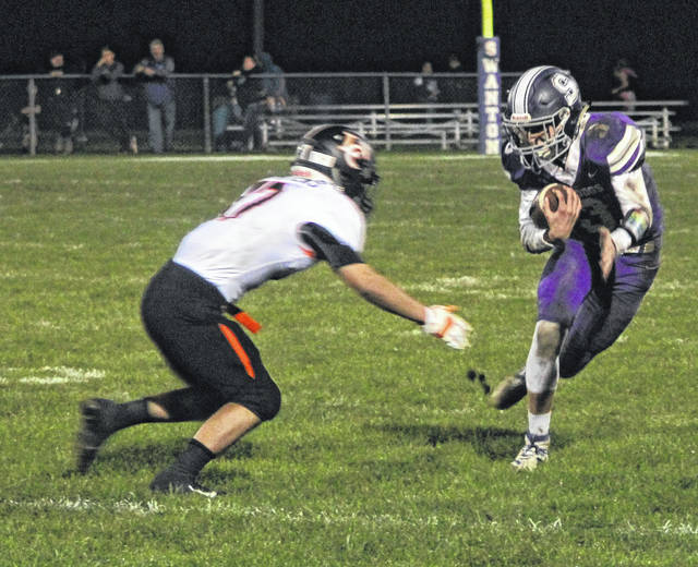 Trent Weigel of Swanton tries to get around a Tiger defender.