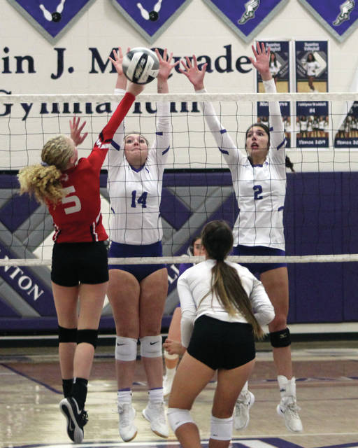 Jessica Dohm (14) and Alexis Sarvo of Swanton jump to block Wauseon's Makayla Kebschull.