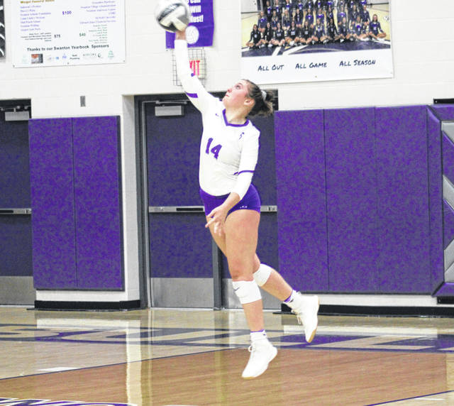 Swanton's Jessica Dohm serves one up during Saturday's match with Cardinal Stritch. Dohm, who was one of six seniors recognized prior to the match, helped lead the Bulldogs to a win over the Cardinals.
