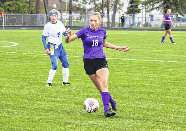 Megan Haselman of Swanton passes a ball to a teammate in the early minutes of Thursday's Division III sectional final versus Miller City. The Bulldogs went on to shut out the Wildcats, 6-0.