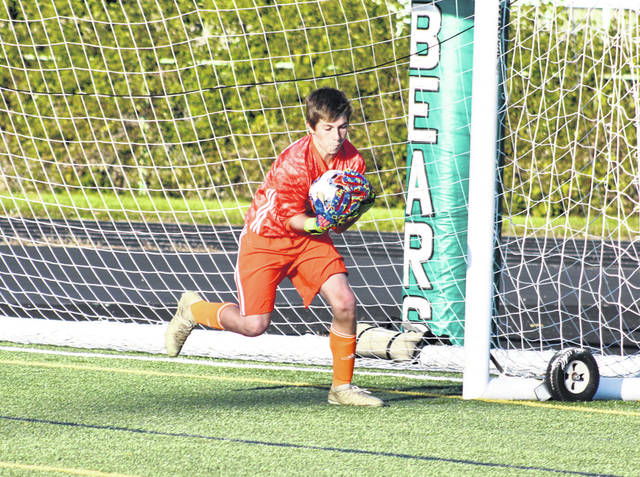 Swanton goalkeeper Ethan Hensley makes a save Wednesday during a Division III district semifinal matchup with the top-ranked team in the state, Ottawa Hills. The Bulldogs fell to the Green Bears 9-0.