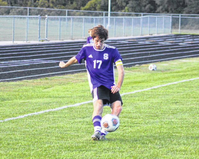 Swanton's Cole Mortermore boots a free kick versus Wauseon on Thursday in NWOAL boys soccer. The Bulldogs fell to the Indians by a 5-3 final.
