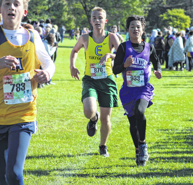 Swanton's Abel Carman, right, races to the finish line with Chandler Ruetz of Evergreen giving chase Saturday at the NWOAL Cross Country meet in Bryan. Carman would take 34th while Ruetz was 35th.