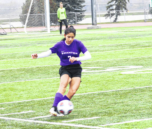 Swanton's Caroline Vargas boots one during Saturday's district final against Archbold. The Bulldogs would fall to the Blue Streaks, 1-0.