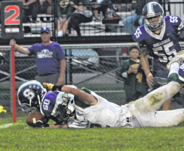 Swanton's Brendan Keith (60) jumps on a fumble in the game against Evergreen this season. Keith was recently selected second team All-Northwest District defense in Division V.