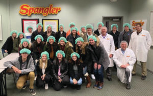 Swanton High School accounting students visit Spangler Candies