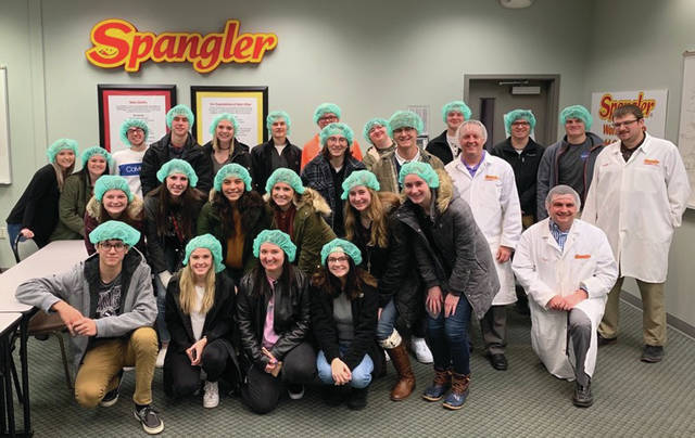 Pictured during the visit to Spangler Candies are, from left, front row: Tyler Anderson, Kara Truckor, Hayley Newton, Alexia Westhoven. Middle Row: Amber Never, Alexis Sarvo, Maya Vargas, Madison Walters, Alexis Bergman, Olivia Bergman and Tyler Sailer, General Accounting Manager. Back Row: Kaitlyn Tyson, Madison Stout, Cole Mortemore, Riley Hensley, Elizabeth Hayes, Mason Sullivan, Evan Carmean, Bruce Vidak, Noah Reiter, Caleb Eckels, Brady Lemons, Matt Dixon, Chief Financial Officer, Ean Comstock, Xavier Wiemken and Nathan Henricks, Cost Accounting Manager.