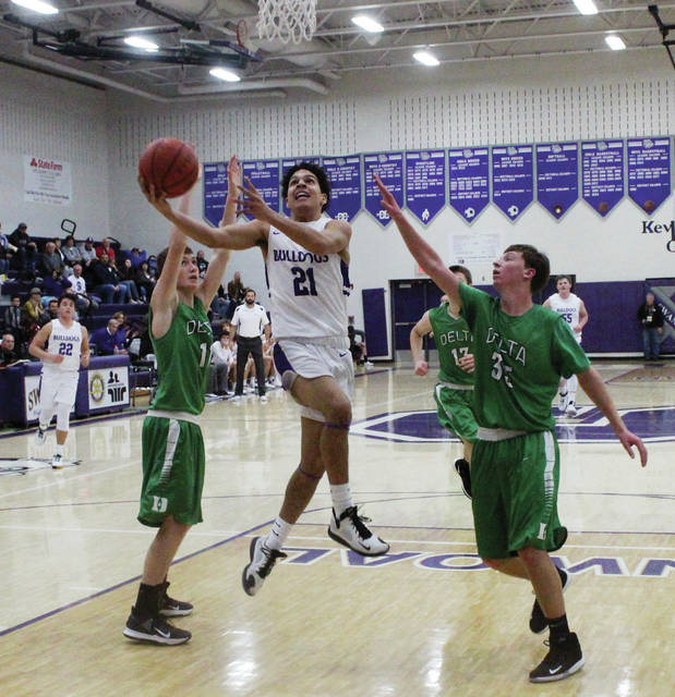 Swanton's Justyn Bartlett drives in for two points against Delta on Friday.