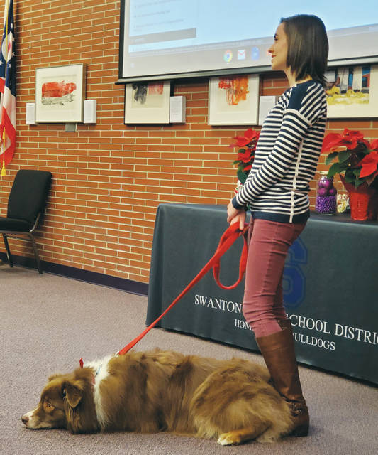 Samantha Schmidt, a Swanton Elementary School intervention specialist, tells the Swanton Board of Education about Charlie, a therapy dog.
