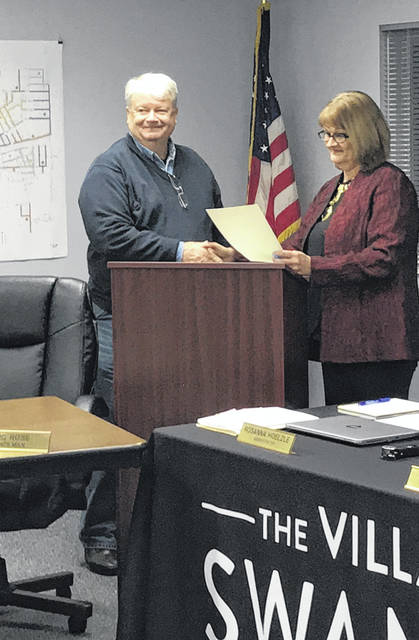 Swanton Mayor Ann Roth reads a proclamation recognizing Jeff Pilliod for his years of service to the village as a council member. Roth was also recognized at the meeting.