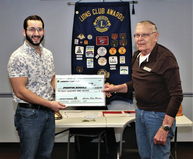 Swanton Lions Club President Richard Notestine presents a check for $1,500 to Swanton High School English teacher Jeffrey Dojcsak to be used to help fund the school's inaugural season of esports. Dojcsak will be coordinating the esports program with competition slated to begin in February of 2020.
