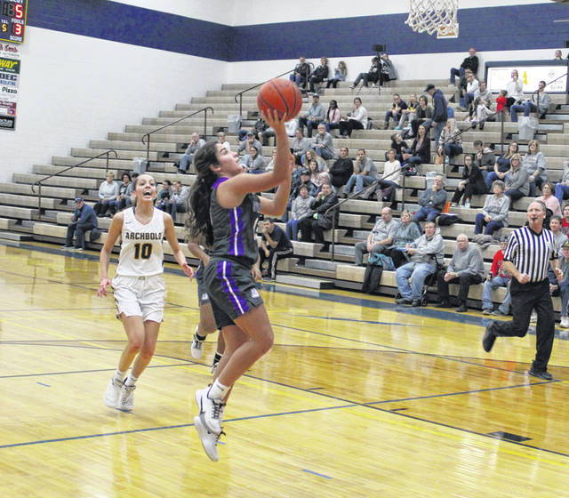 Aricka Lutz of Swanton scores on a fastbreak during Friday's NWOAL opener at Archbold. She led all scorers with 19 points, but the Bulldogs fell to the Blue Streaks 48-41.