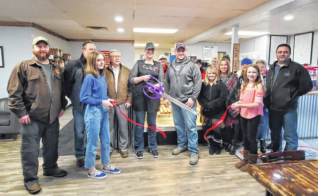 CK Sweets Coffee and Bake Shop opened with long lines Saturday as a grand opening and ribbon cutting were held. Above, owner Cat Kania is surrounded by family, employees, and Chamber of Commerce members as she cuts the ribbon.