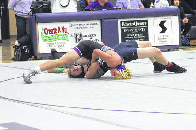 Swanton's Hunter Gowing, top, won by pin against Montpelier.