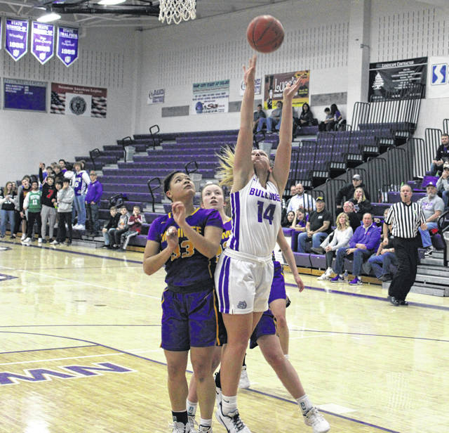 Morgan Pine of Swanton draws a foul inside versus Maumee on Tuesday. The Bulldogs were in control the whole way as they rolled to a 48-23 win.
