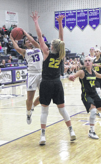 Aricka Lutz of Swanton drives to the basket for a shot against Evergreen as Morgan Foster defends.