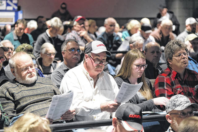Local farmers look on during a meeting at Owens Community College Tuesday afternoon.