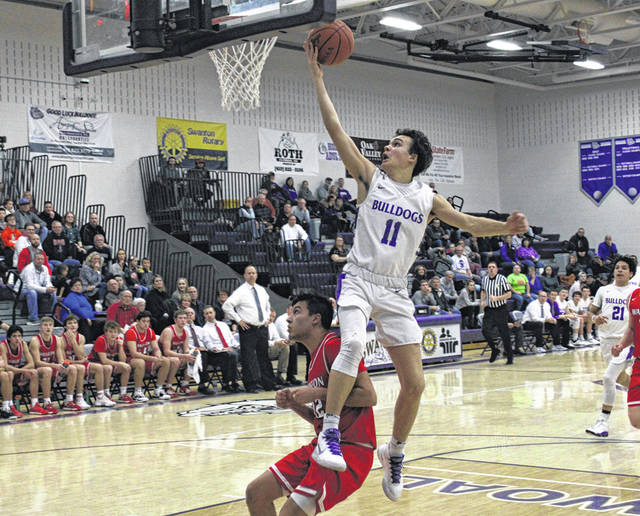 Sam Betz of Swanton lays one in and would tack on a free throw for a three-point play Friday night against Wauseon. However, after holding a 24-21 halftime lead, the Bulldogs fell to the Indians by a 47-38 final.