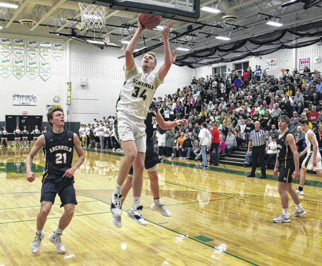 Nate Brighton with an easy layup for Evergreen during Friday's NWOAL matchup with Archbold. The Vikings, with a 49-35 win over the Blue Streaks, secured at least a share of the league title.