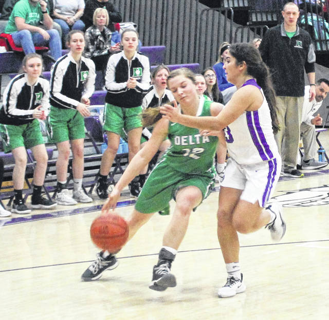 Swanton's Aricka Lutz draws a charge against Brooklyn Wymer of Delta on Thursday.