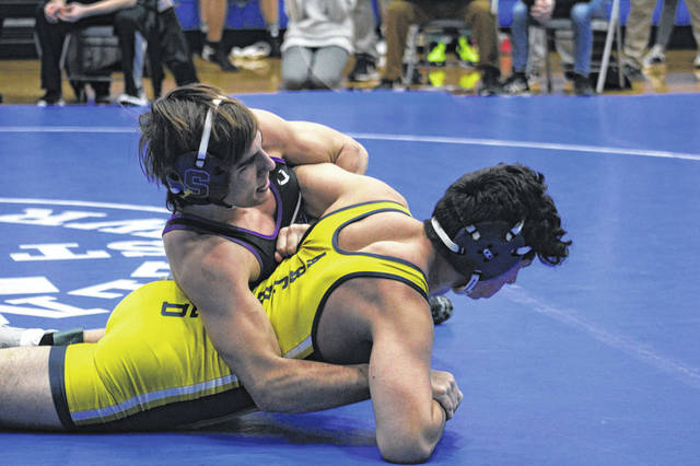 Tyler Gowing of Swanton, top, in action against Archbold's Jose Luna at 160 pounds during the Division III, Region 17 Dual Tournament Saturday at Elmwood. Gowing earned one of two Bulldog wins in the dual, pinning Luna in 3:35.