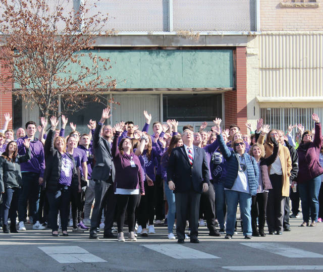 "Swanton residents, organized in the shape of a heart on Main Street, wave to a drone on Monday. The drone was filming for a video the village submitted for the HGTV show ""Home Town Takeover."""