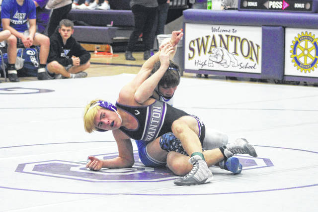 Hunter Gowing of Swanton wrestles against Bryce Gilts of Anthony Wayne on Thursday. The Dogs fell to the Generals 61-18, and also lost a dual with Liberty Center 60-15.
