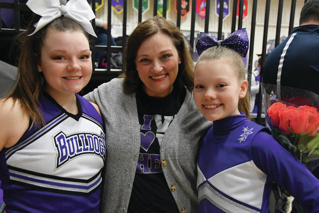 Kerri Rochelle, pictured with daughters Macie and Mylee, was recognized Friday for her many years with the Swanton Recreation cheerleading program. She had been with the program since 2004.