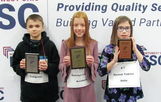 Grade 4 placers were, from left, Alex Boothby, second place; Katelyn Liechty, first place; Hannah Tedrow, third place.