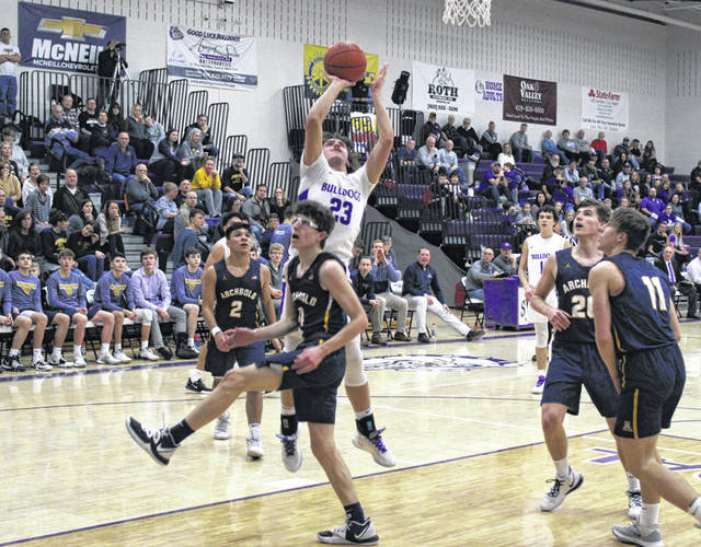 Andrew Thornton of Swanton scores over an Archbold defender during Friday's NWOAL and regular season finale. The Bulldogs were defeated by the Blue Streaks, 50-39.